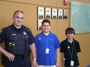Peter and Alex with Officer Hernandez at the Niles Police Department